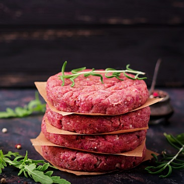 fresh-raw-homemade-minced-beef-steak-burger-with-spices-black-background_2829-1479
